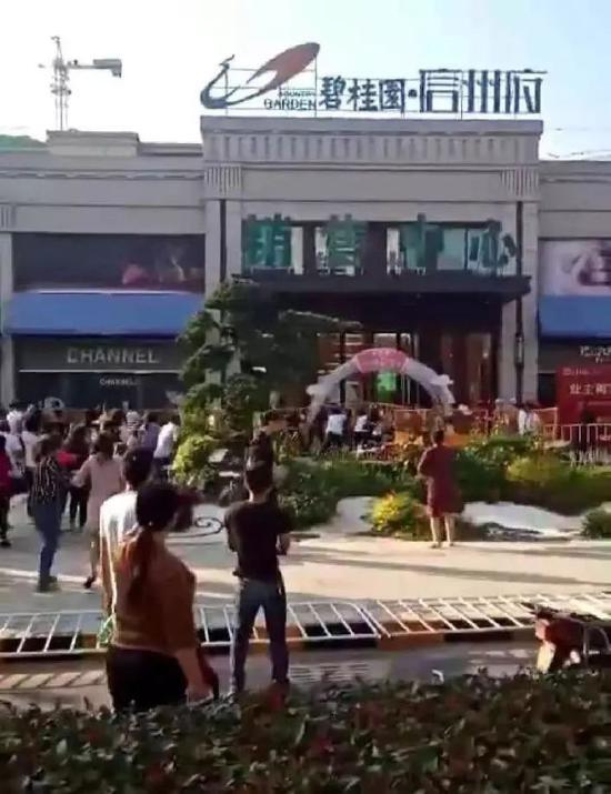 中国多地因楼盘降价引发纠纷 楼市几大信号不可不重视_图1-3