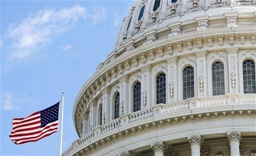 众议院将在周五纾困法案投票中保留调涨最低工资条款_图1-1