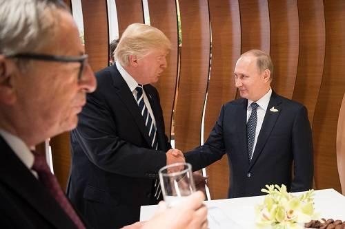 普京调侃没想策反美第一夫人 两人曾在G20上见面_图1-1