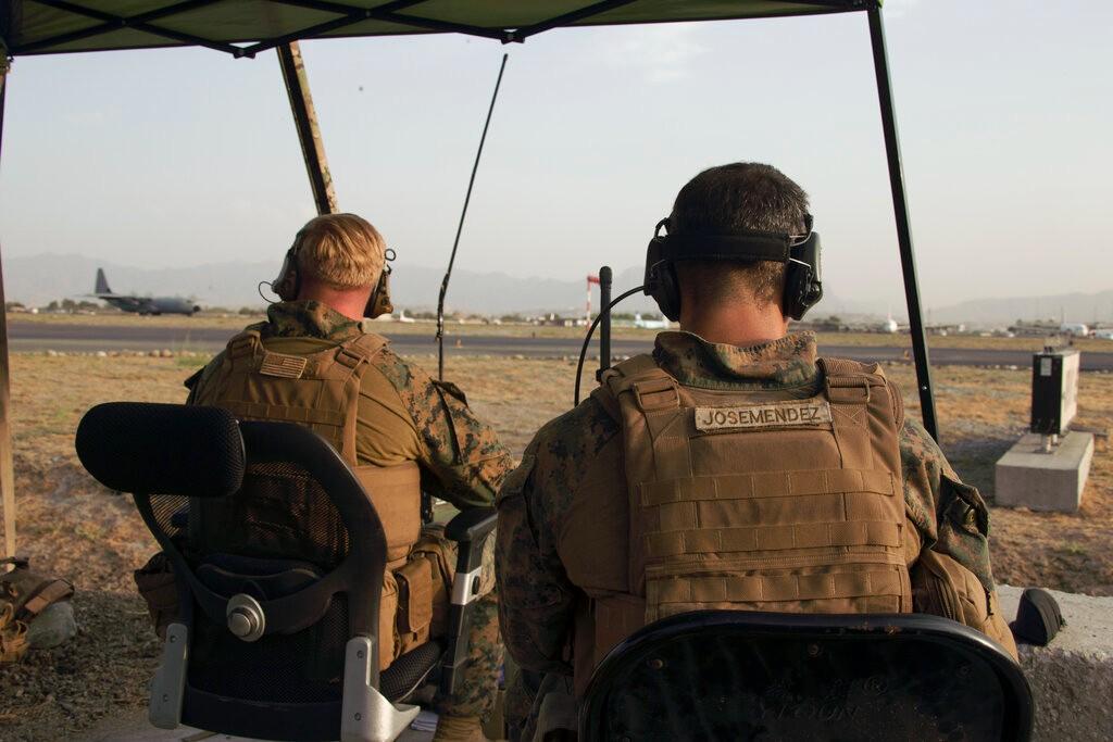 拜登宣布维持31日阿富汗撤军期限:停留越长越危险_图1-4